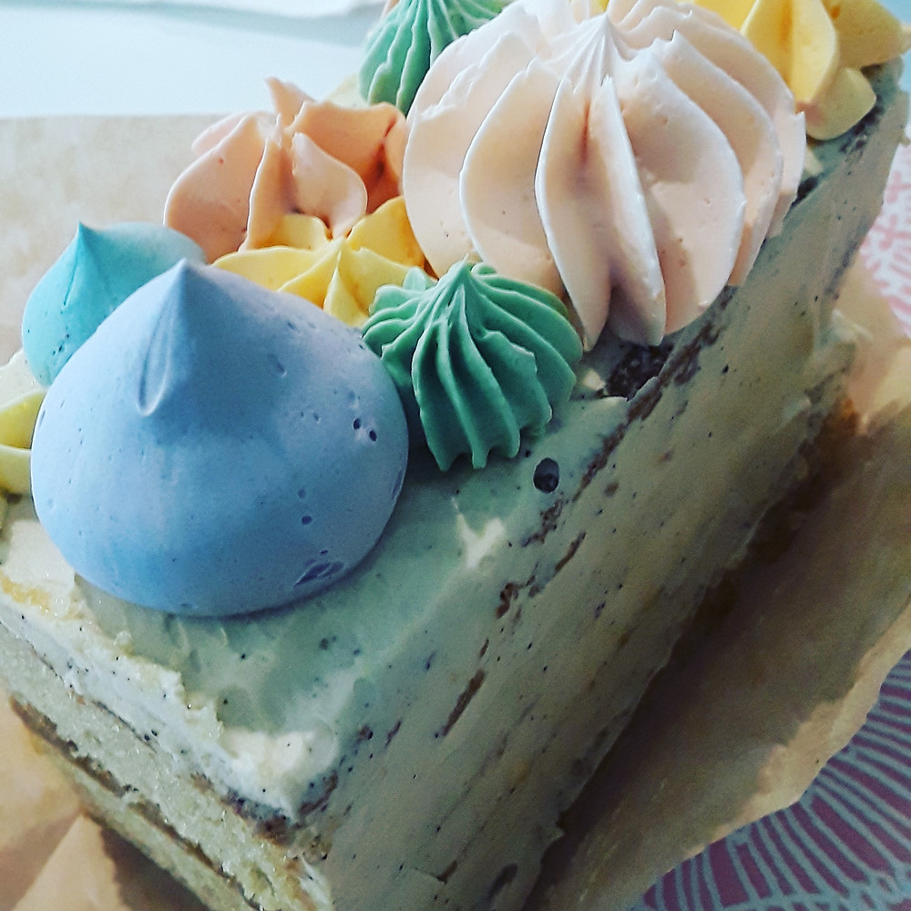 Random photo of a slice of cake I ate at a bakery in Champaign, Illinois and not the cake I talk about in this post.