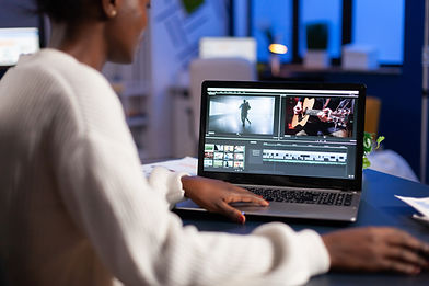 black-video-editor-working-overtime-at-new-project-SJWYXG6.JPG