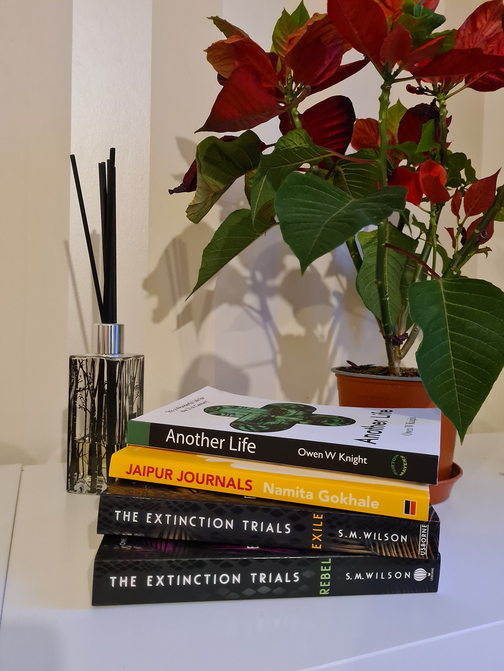 Pile of books - Extinction trials, Jaipur Journals and Another life