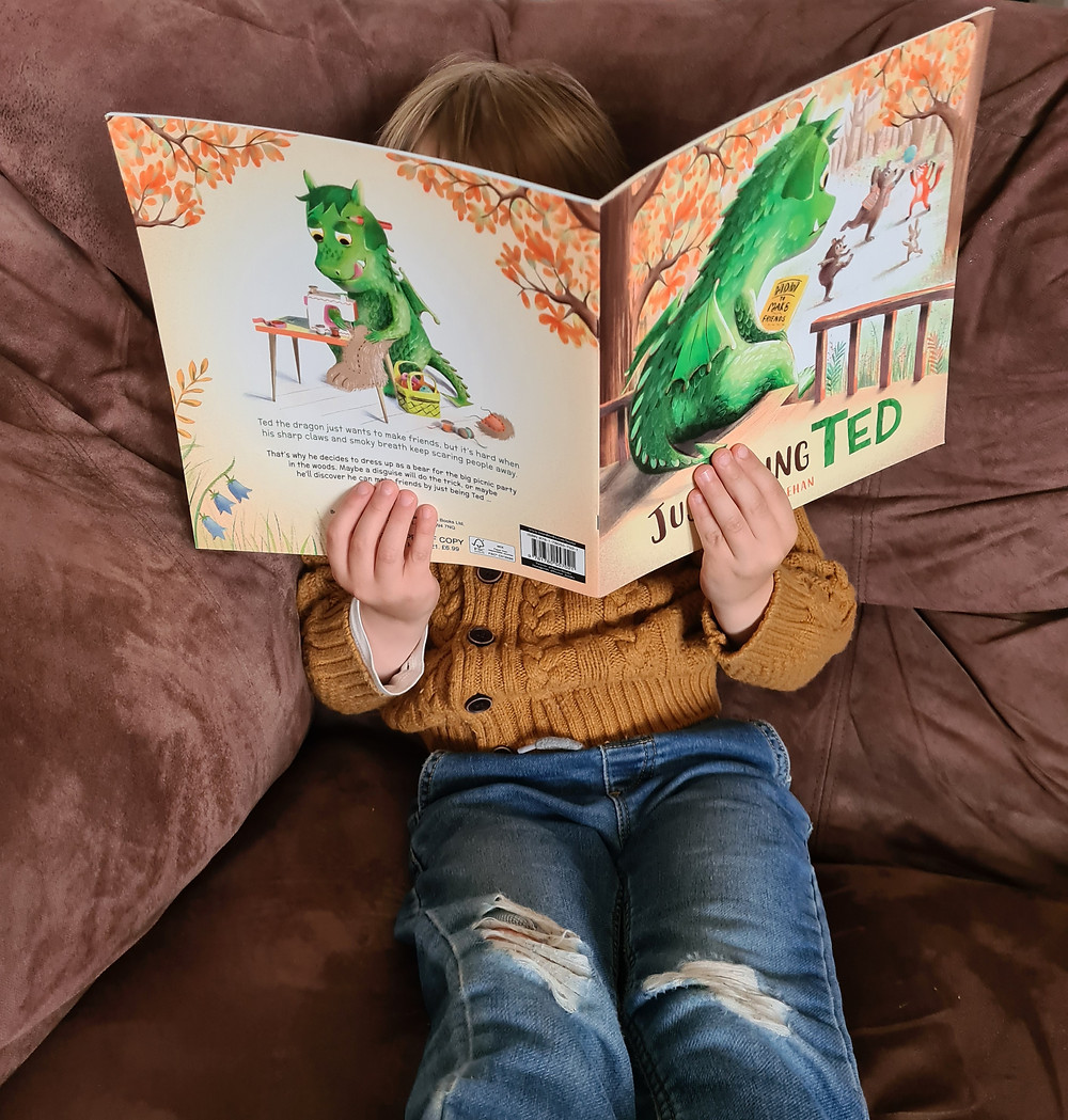 Child reading Just being Ted by Lisa Sheehan