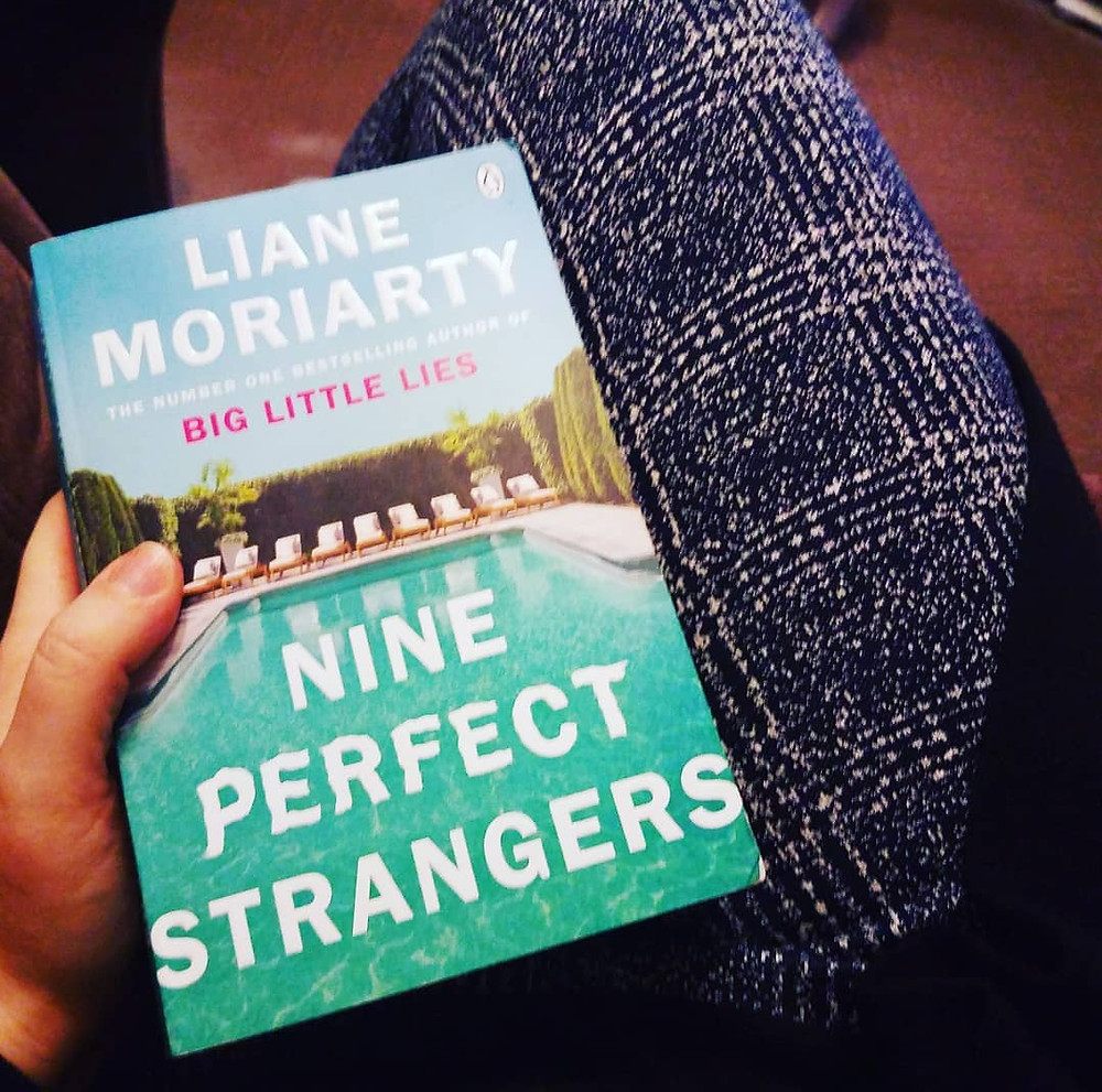 Nine perfect strangers by Lianne Moriarty - book cover