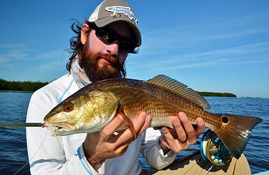 alex redfish on fly.JPG