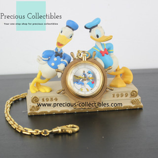 Donald Duck statue with pocket watch