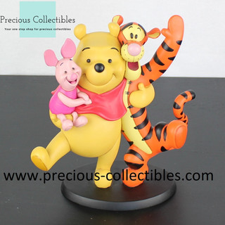 Winnie the Pooh, Piglet and Tigger statue