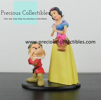 Snow White and Grumpy statue