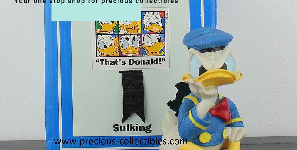 Donald duck;sitting;sulking;sculpture;statue;figurine;collectible;shop;walt disney;store;for sale;precious collectibles;comic