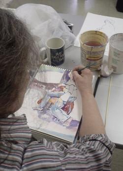Artist working on her painting in the Trenholm Workshop.jpg