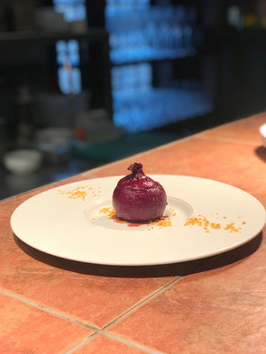 Slow baked red onion stuffed with goats