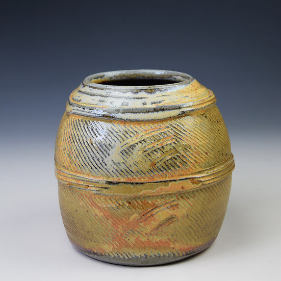 Squat squared soda-glazed vessel
