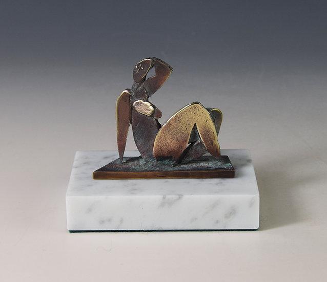 Semi reclining nude in bronze