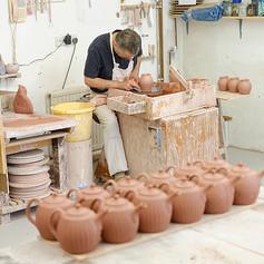 My husband John making teapots
