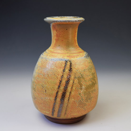 Soda fired footed bottle