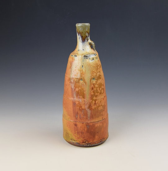 Tall soda fired bottle with a lug