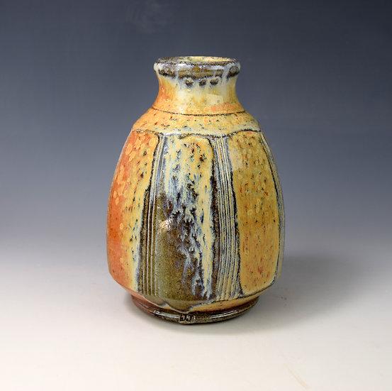 Faceted soda fired bottle vase