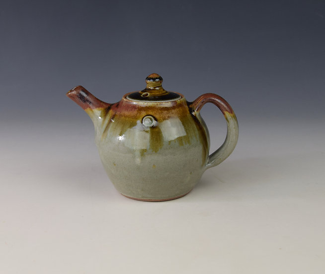 "1-person teapot with ""red top"""