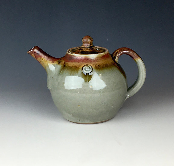 "1-pint ash glaze teapot with ""red top"" and sprigged dots"