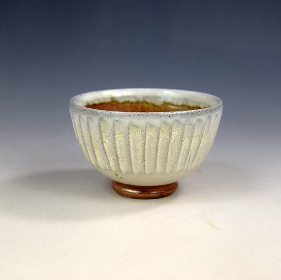 Soda fired open tea bowl