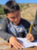 student writing in journal.jpg