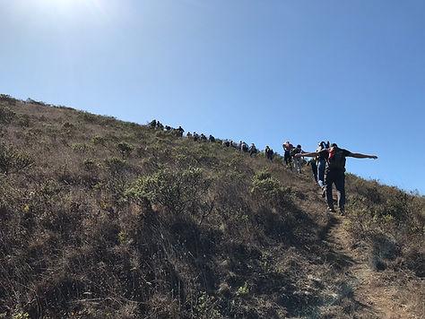 Students hiking up Walker Peak