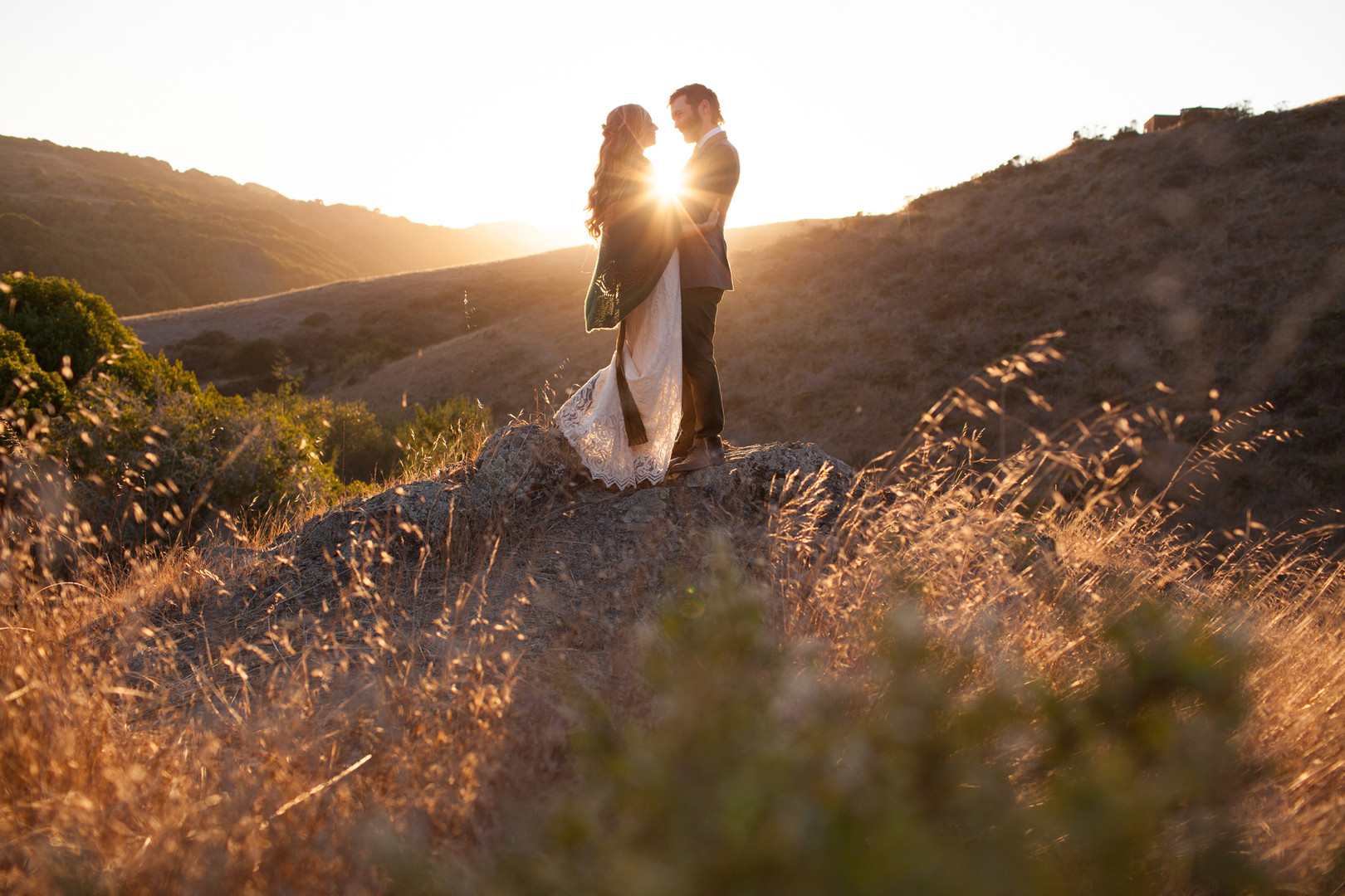 Two people getting married in the sunset