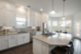 White Kitchen with granite counter-tops and white cabinets Brollagio Hollering Pass lodging