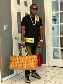 DJ Fury in D&G with MCM travel bag