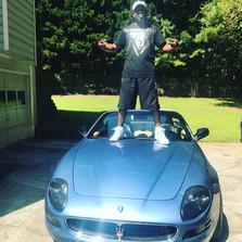 DJ Fury standing on his Maserati