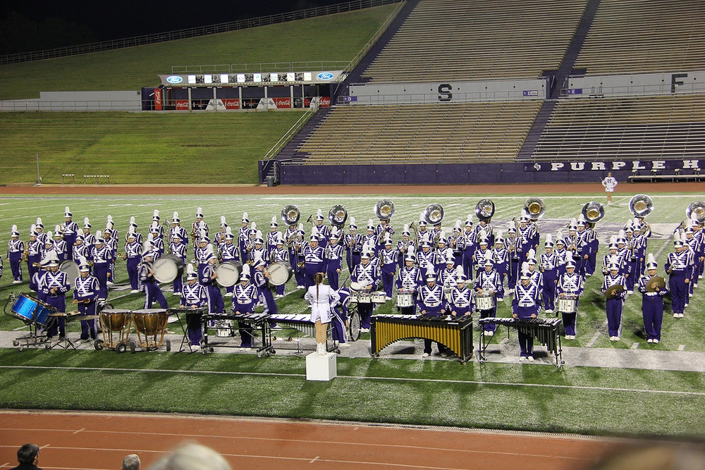A marching band on the football field in performance