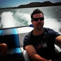 adam pic in boat.jpg