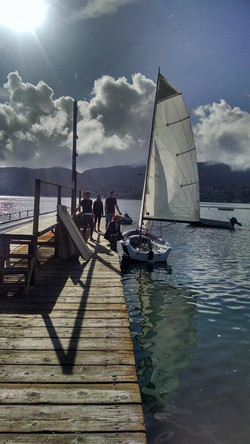 customers arrive by sailboat