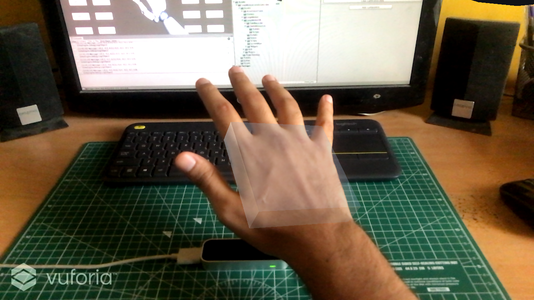 The translucent cursor overlaid on the user's hand.