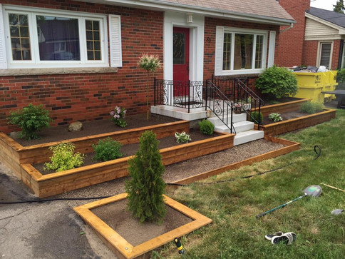 multiple raised garden beds walkway land