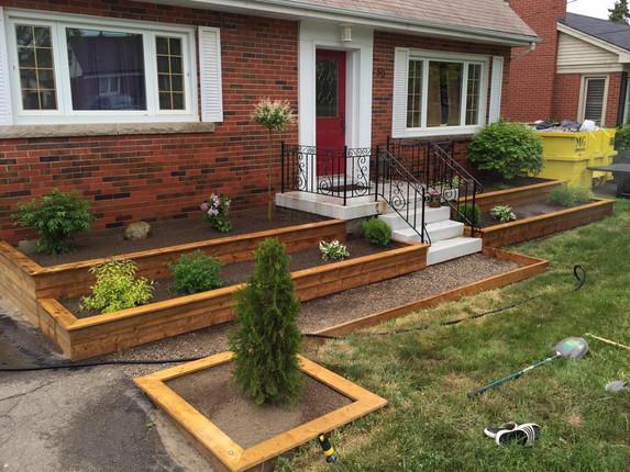 multiple raised garden beds walkway land