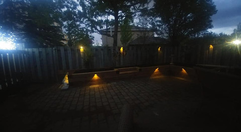 night time patio after landscapers desig