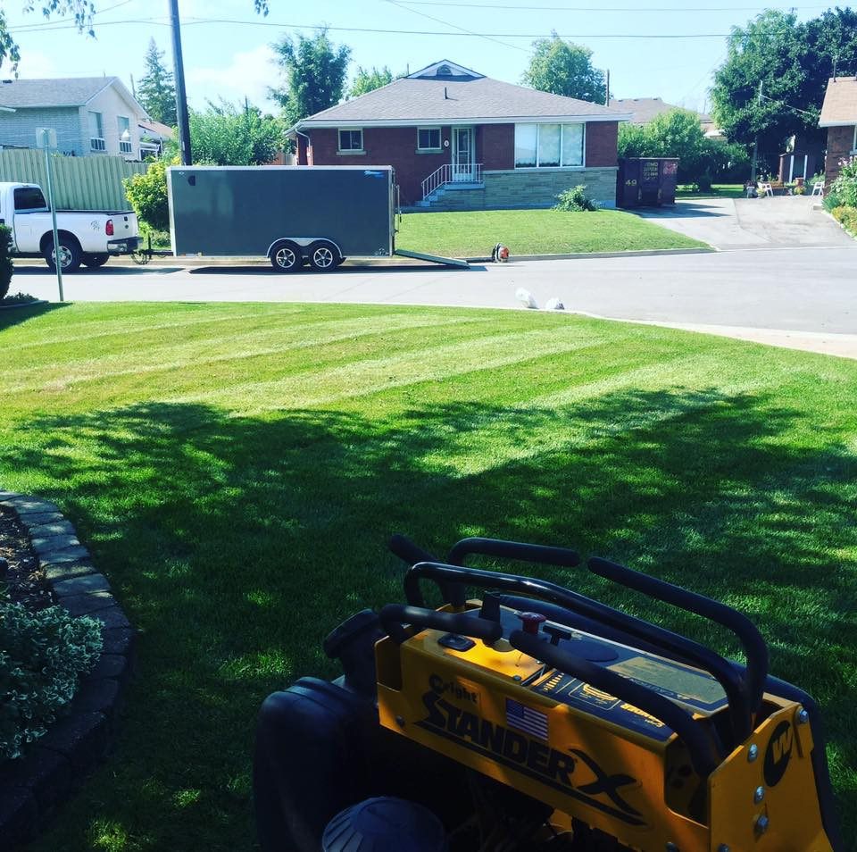 Legendary Landscapes truck trailer lawn mower, green grass maintenance hamilton