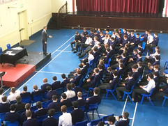 Blackrock College students learning presentationial skills through performing magic tricks.