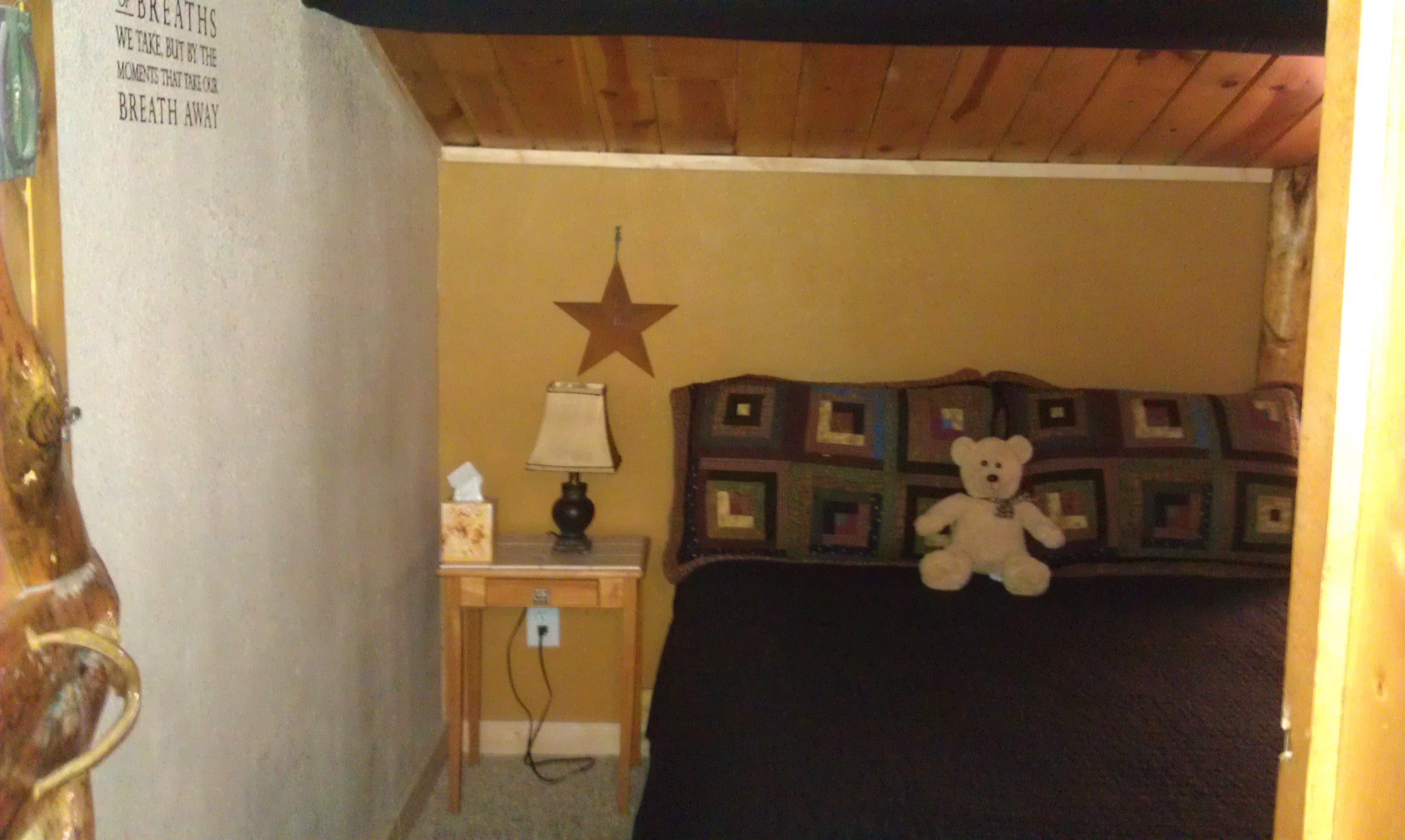 Separate bedroom with queen bed.