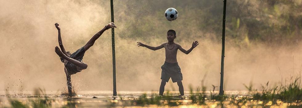 Joy of sports - football soccer - children plaing and having fun