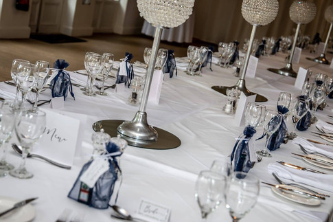 Navy and black tie wedding table station
