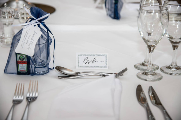 Black tie with silver glitter placecards