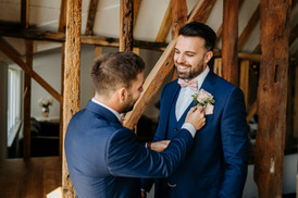groom in navy with blush rose