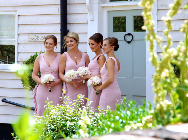Blush bridesmaids with their bouquets.jp