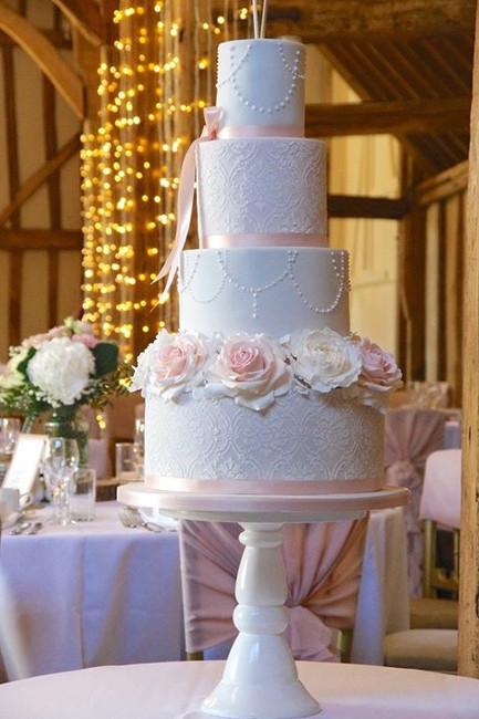 beautiful blush and white wedding cake