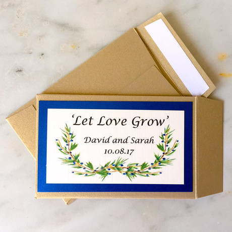 Bespoke seed packet favours in pale gold and royal blue