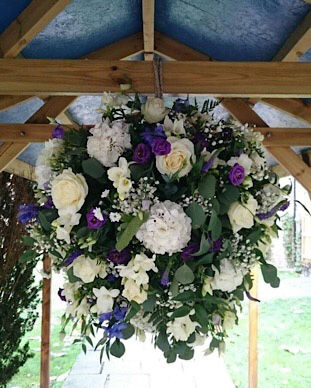 huge hanging ball of flowers for wedding