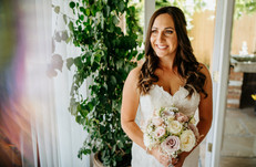 bride in white with rose bouquet