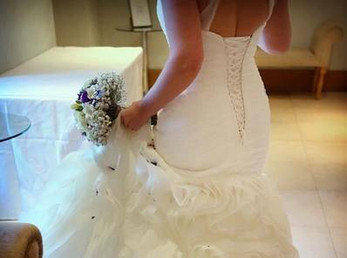 wedding dress and bridal bouquet