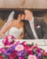 bright pink and purple wedding flower ar