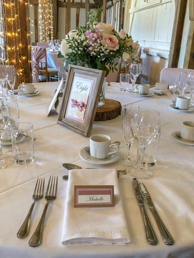 blush and kraft barn table setting