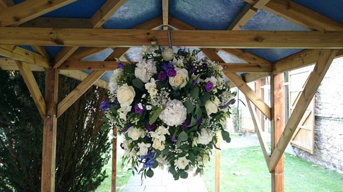 purple and white hanging flower ball